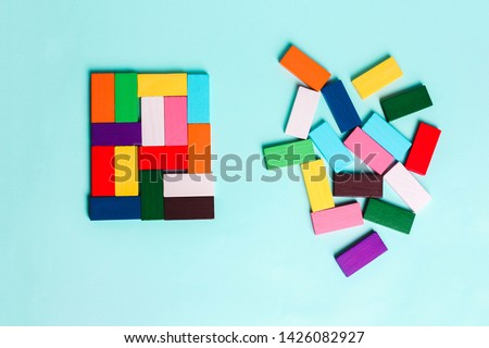 order and chaos. Chaotic unorganized colored dominoes and ordered. Concept of business model, organization. Left and right hemisphere of the brain.