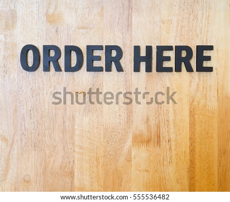 Order here sign on wood wall  #555536482