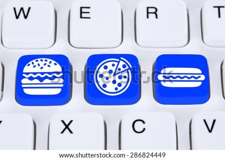 Ordering pizza hamburger online fast food order delivery fastfood internet on computer