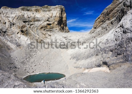 Ordesa & Monte Perdido National Park in Spain, Europe on a sunny day of summer / autumn - Lake Helado and tourists hiking - Tourist adventure travel destination