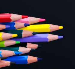 ordinary colored wooden pencil with soft lead of different colors for drawing and creativity, close up of pencils after sharpening and using, pencil made of natural materials safe for children