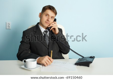 Ordinary official working in the office - talking on the phone