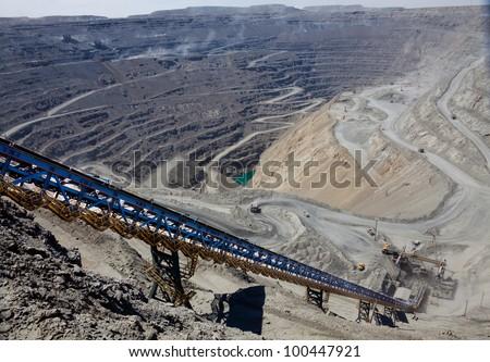 ore conveyor in open pit mining - stock photo