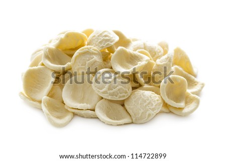 orecchiette pasta raw uncooked in a heap isolated on a white background