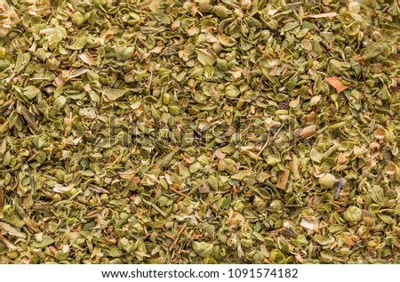 Oregano spice detail macro texture background pattern. Spilled oregano spice macro. #1091574182