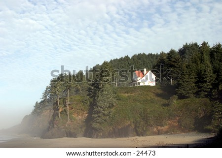 oregon light house keepers, house in the woods with fog moving in