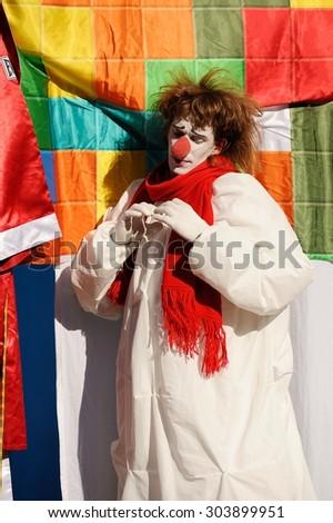 Orel, Russia, August 01, 2015: Mumu Fest, Turgenev\'s story art-festival,  mime, pantomime, clown keep hands in a heart shape