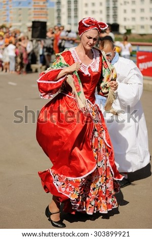 Orel, Russia, August 01, 2015: Mumu Fest, Turgenev\'s story art-festival, mimes and actor in red dress dancing