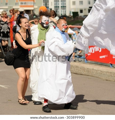 Orel, Russia, August 01, 2015: Mumu Fest, Turgenev\'s story art-festival, mimes, pantomime, clowns dancing with girl