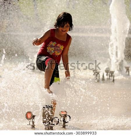 Orel, Russia, August 01, 2015: Mumu Fest, Turgenev\'s story art-festival, the girl in the fountain
