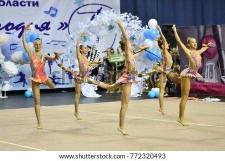 """Orenburg, Russia - November 25, 2017 year: girls compete in rhythmic gymnastics on the Orenburg region Championship on rhythmic gymnastics """"Winter melody-2017"""". #772320493"""