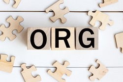 ORG- text on wood cubes on a WHITE background. puzzles