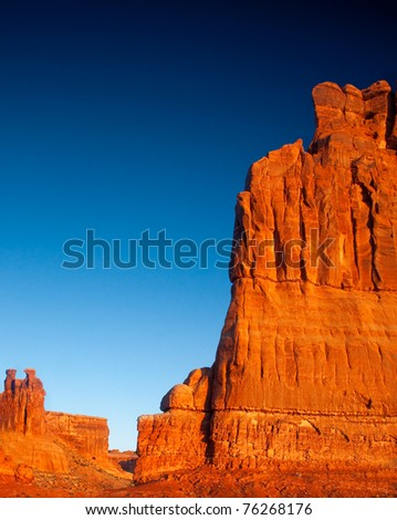 Organ Rock and two of the three Gossips under sunrise light - Arches National Park, Utah.