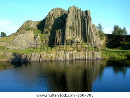 Organ rock with lake in the Czech republic - stock photo