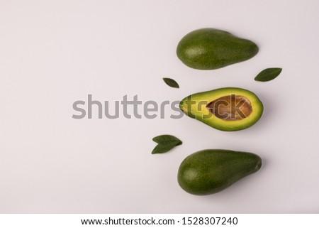 Organic avocado with seed, avocado halves and whole fruits on white background. Fresh ripe avocados. #1528307240
