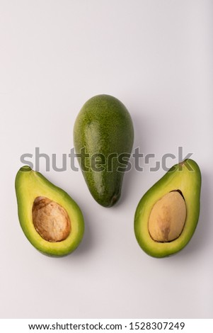 Organic avocado with seed, avocado halves and whole fruits on white background. Fresh ripe avocados. #1528307249