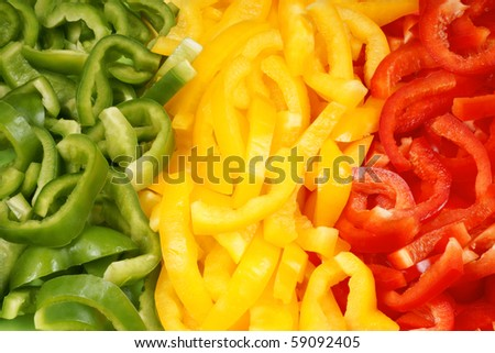 Organic background made of slices of green, yellow and red bell pepper. Organic flag of Mali.