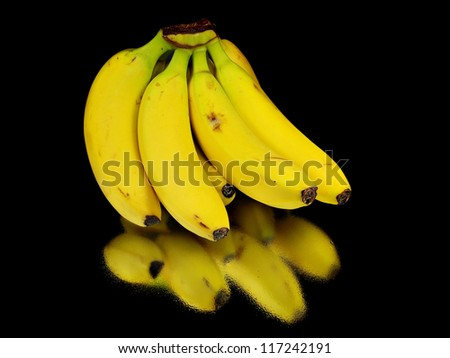 organic bananas on a black background with water drops