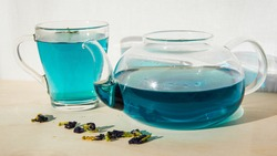 Organic Blue Anchan Tea in a glass teapot and cup. one cup and teapot butterfly pea flower blue tea Healthy Detox Herbal drink.