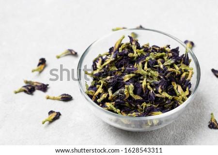 Organic blue tea Anchan, Clitoria, Butterfly Pea. Blue Anchan tea, dried tea flowers(Flowers of the clitoris triplicate)  in a bowl.