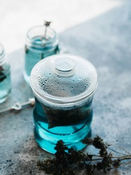 Organic blue tea Anchan, Clitoria, Butterfly Pea in a teapot and a cups