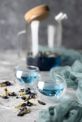 Organic blue tea Anchan, Clitoria, Butterfly Pea in a teapot and a cups.