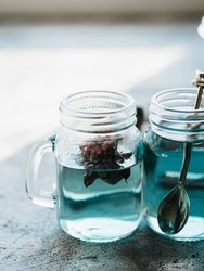 Organic blue tea Anchan, Clitoria, Butterfly Pea in a teapot and cups