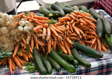 Organic carrots, zucchini, squash, and garlic at the local farmers market