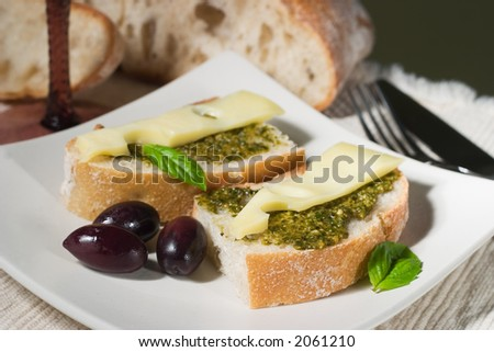 Organic ciabatta bread with pesto dressing with cheese and black olives