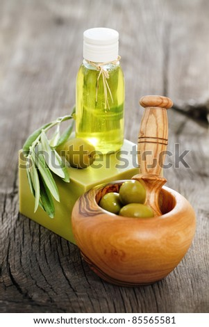 Organic cosmetics from olive oil on the wooden background