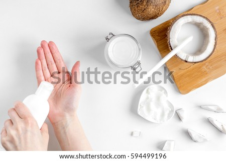 organic cosmetics with coconut on white background top view #594499196
