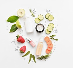 organic cosmetics with eatable ingredients. cucumber, carrot and strawberry as cream and serum components. home grown cosmetics. flat lay.