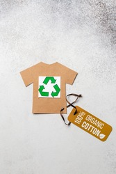 Organic cotton clothing concept with label. Paper craft t-shirt. Eco-clothing