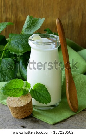 organic dairy products (yogurt, sour cream) in a glass jar
