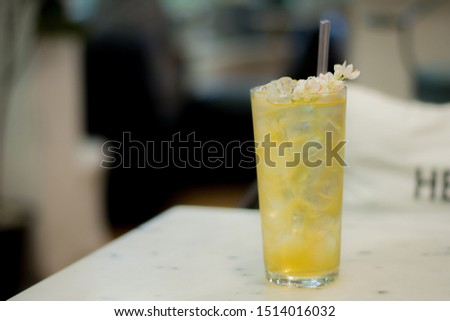 organic flower tea, honey, ice and little flowers in clear cup with clear straw, Concepts for healthy and reducing plastic usage, soft focus