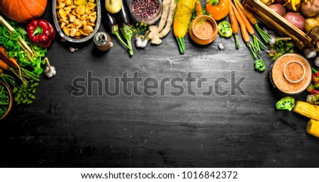 Organic food. Fresh harvest of vegetables and fruits. On the black chalkboard. #1016842372