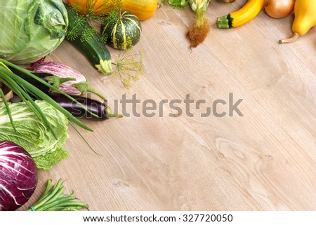Organic foods background. Space for your text / high-res product, studio photography of different vegetables on old wooden table.