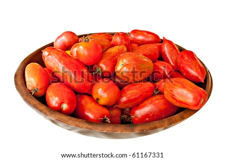 Organic fresh picked tomatoes in bowl isolated on white
