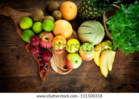 Organic Fruit variety on wood. Tropical exotic food concept.