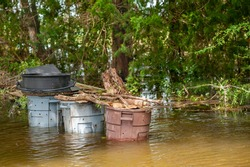 Organic gardening compost bins submerged under two feet of salty floodwater, from Hurricane Laura's strong storm surge, located in South Louisiana.