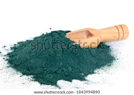 Organic green spirulina algae powder in a wooden spoon isolated on white background, Spirulina or seaweed is a superfood used as a food supplement source and detox healthy nutrition-concept Foto stock ©