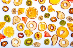 Organic Healthy Assorted Dried Fruit Mix close up. Dried fruit snacks. dried apples, mango, feijoa, dried apricots, prunes top view