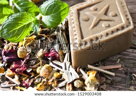 Organic herbal soap on wooden background