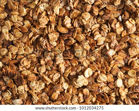 Organic homemade Granola Cereal with oats and almond. Texture oatmeal granola or muesli as background. Top view or flat-lay. Copy space for text. Stockfoto ©