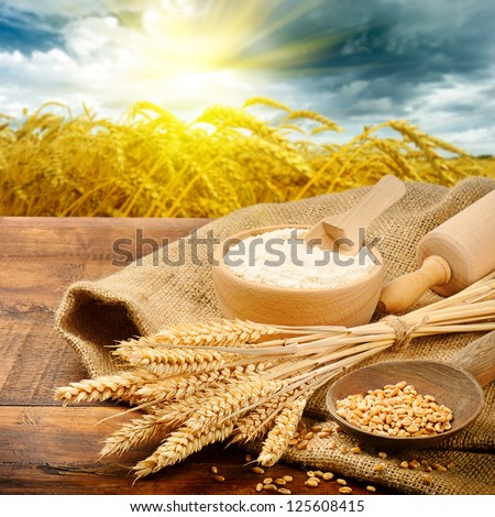 Organic ingredients for bread preparation with golden sunrise on background #125608415