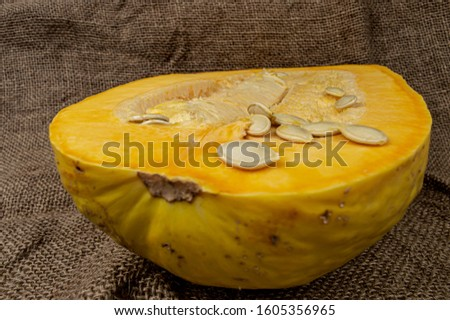 organic juicy pumpkin pulp with seeds and pulp close-up