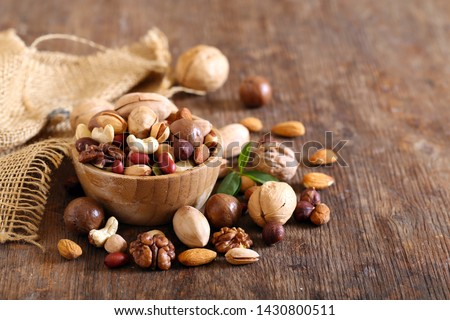 organic mix nuts on a wooden table #1430800511