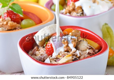 Organic muesli with fresh fruit and milk