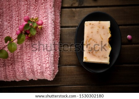 Organic natural hand made soap with calendula petals, cold process, with rose towel and rose berries, spa concept, home spa , sauna concept, relax and body care, spa treatment hoemade, close up
