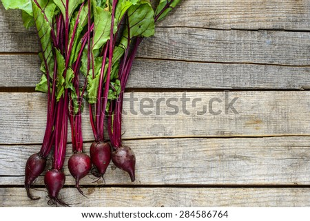 Organic new raw beets on wooden background